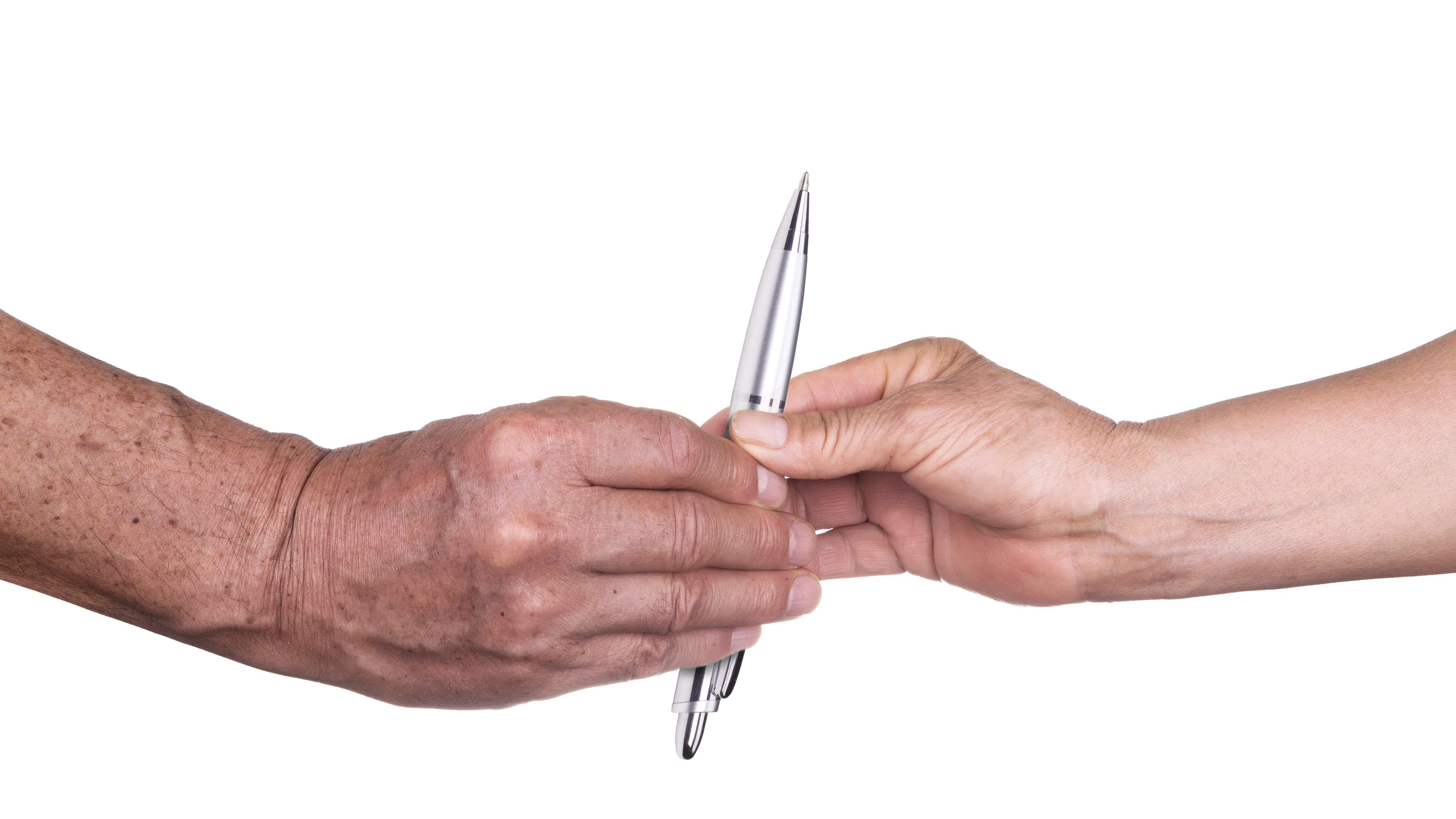 Person handing pen