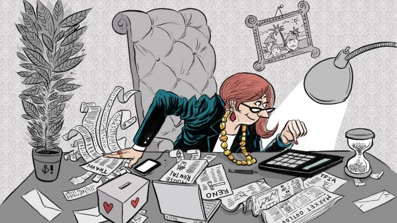Woman sitting in her office filing her taxes